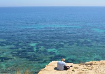 Cliff view to the turquoise water sea